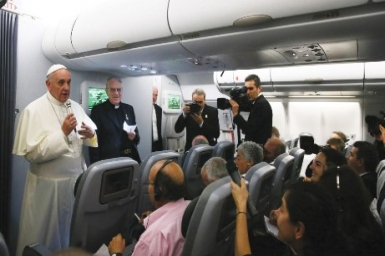 Pope Francis holds hour long in-flight question and answer session with journalists