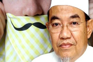 Islam twisted in M`sia? Hankies are for blowing noses, NOT beating wives