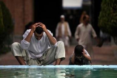 Swimming instead of wudu' for prayer