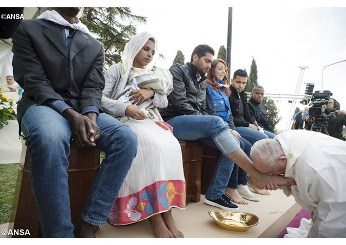 Pope says gestures speak louder than words, and washes the feet of refugees