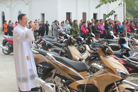 Vietnam Catholics have vehicles blessed on Lunar New Year